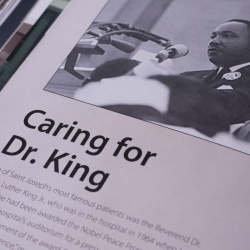 Dr.Martin Luther King Jr Photo in Hospital Book by Atlanta Book Cover Designer for Anniversary Celebration