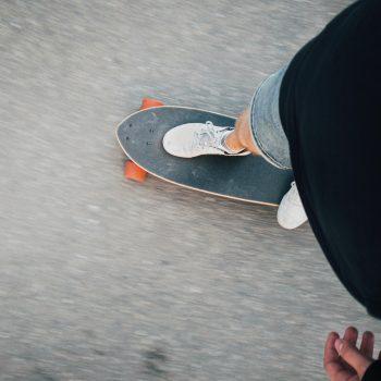 Web designer in Atlanta riding skateboard (a longboard)